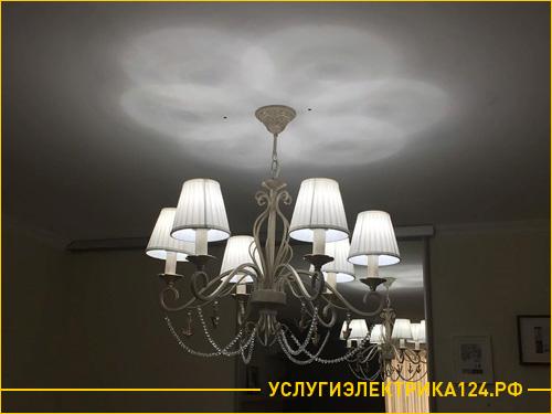 Результат работы по установке люстры в спальне